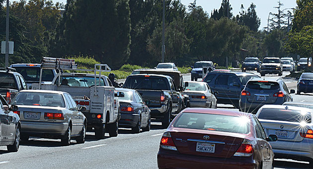 Rush-hour traffic at the busy intersection of Storke Road and Hollister Avenue is expected to become more congested due to developments that are under construction or planned in the area. (Mike Eliason / Mission & State photo)