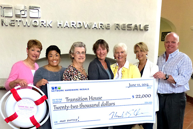 <p>Mike Sheldon of Network Hardware Resale presents the matching funds from the Transition House Auxiliary Mad Hatter luncheon to, from left, co-chairs Diane White and Kathryn Dinkin, Transition House Executive Director Kathleen Baushke and outgoing Auxiliary president Missy Sheldon.</p>