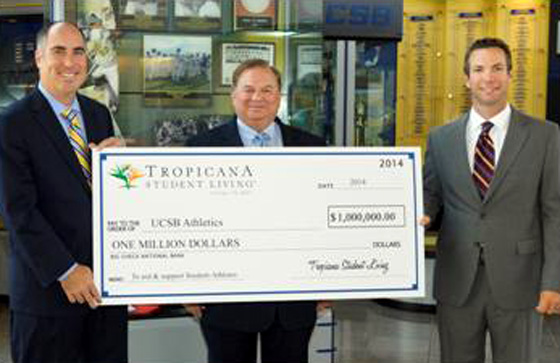 <p>Kent Dunn, center, managing principal of Tropicana Student Living, presents check to Mark Massari, left, director of UCSB Athletics, and Andrew Checketts, head baseball coach, at the Intercollegiate Athletics building.</p>
