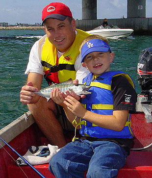 Ed Roberts with son Daniel, proudly displaying Daniel's first bonito.