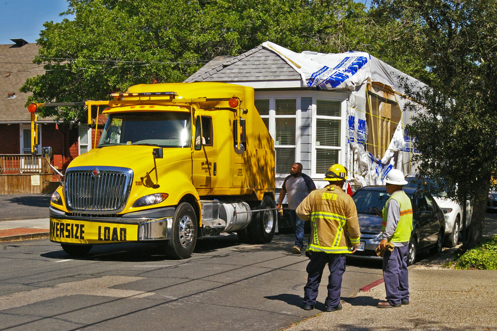 Part of a mobile home being hauled by truck up Chapala Street got stuck on overhead utility wires Wednesday afternoon in Santa Barbara.