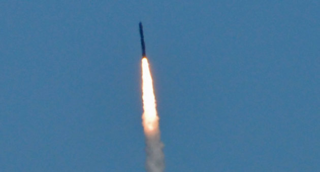 <p>A missile-defense interceptor soars into the sky Sunday at Vandenberg Air Force Base, during a test of the system. Officials said the missile successfully destroyed its mock target.</p>