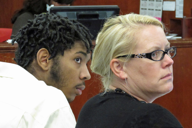 Former Allan Hancock College basketball player Ali Mohammed sits next to his defense attorney, Lori Pedego, in court on Tuesday. Mohammed is one of two former players charged with a fatal shooting late last year.