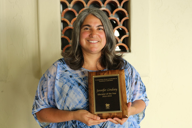Jennifer Lindsay, Harding University Partnership School teacher, is the first to be named on the district's new Educator of the Year perpetual plaque.