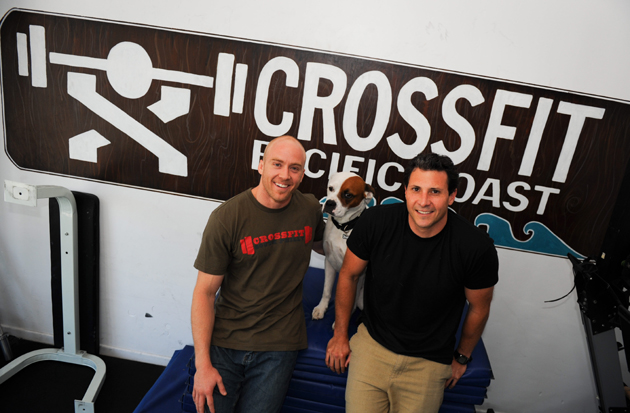 <p>Co-owners Traver Boehm, left, and Eric Malzone opened CrossFit Pacific Coast two years ago in Santa Barbara, and its membership continues to grow.</p>
