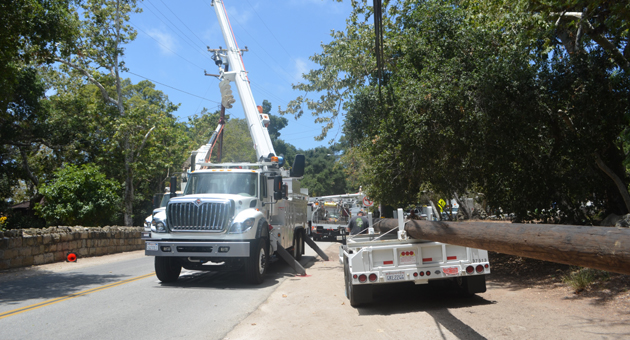 <p>Southern California Edison crews work Wednesday to restore power and replace a power pole after a driver crashed into it. Mission Canyon Road remains closed at Rocky Nook Park.</p>