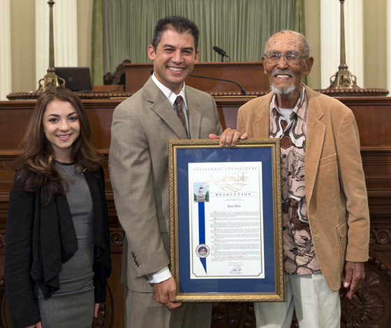 <p>Assemblyman Das Williams, center, honors René Diets as the 2014 Veteran of the Year. At left is Olivia Klein, Diets' granddaughter.</p>