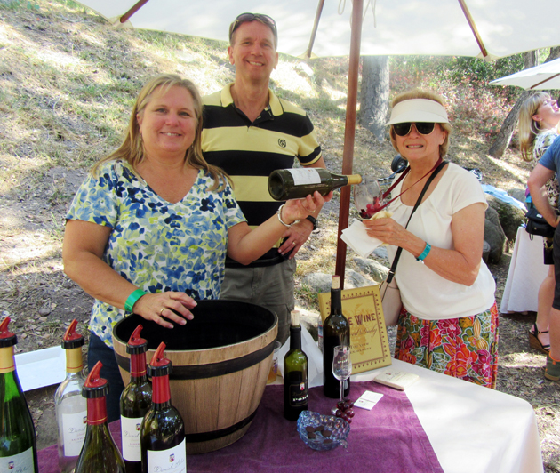 Laureen and Don Clarkson from Daniel Gehrs Wines served to attendee Linda Stiehl.