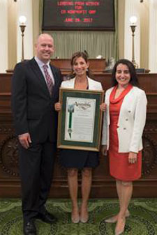 Assemblymember Monique Limón, right, honors Leading From Within members Carrie Randolph and Geoff Green.