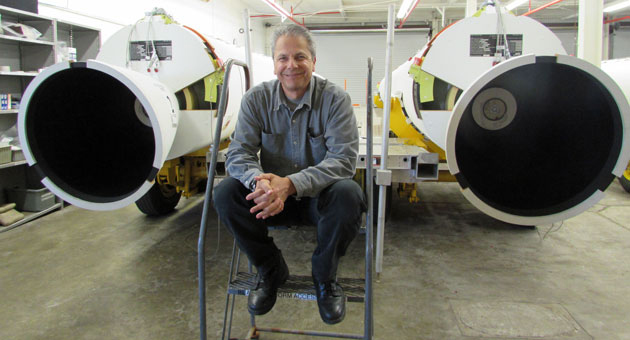 <p>United Launch Alliance employee Doug Adams works with the Delta 2 solid rocket motors. He is pictured with three of those motors lying on trailers while waiting for a trip to Space Launch Complex-2 at Vandenberg Air Force Base for the next Delta 2 mission later this year.</p>