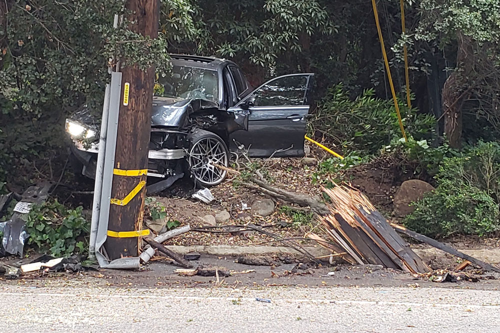 Wrecked vehicle and utility pole
