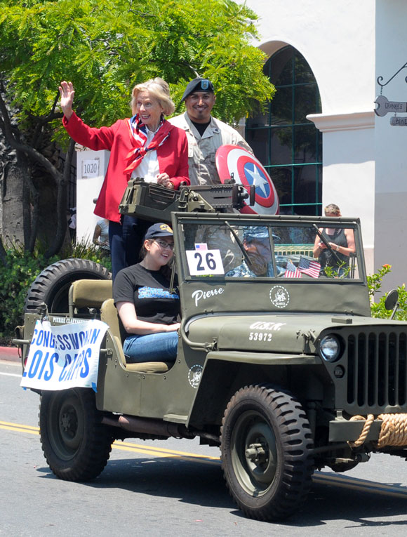 Rep. Lois Capps, D-Santa Barbara, and Iraq War veteran Raymond Morua ride in the Independence Day Parade.