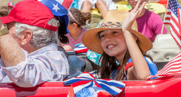 <p>A participant waves to the crowd during Friday&#8217;s Fourth of July parade in Montecito.</p>