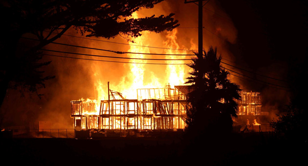 Flames and frames at a UC Santa Barbara student housing complex under construction at Storke Road and Whittier Drive. (Peter Conover photo)