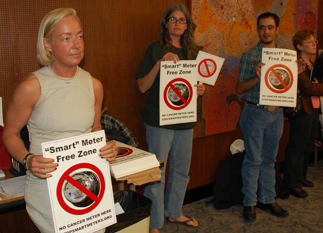 Britta Bartels, left, Daniella Ardo, center, and others gather outside Tuesday's Santa Barbara County Board of Supervisors meeting to protest the installation of residential smart meters.