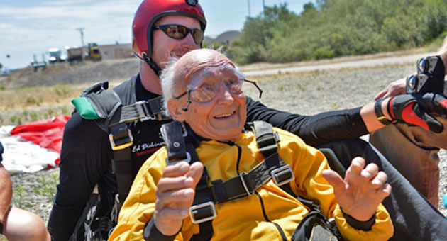 Lorin Brown of Arroyo Grande is all smiles Sunday after completing a parachute jump in Lompoc to mark his 100th birthday. (Frank Cowan / Noozhawk photo)