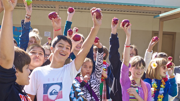 "<p>Middle school students participate in the ""Apple Crunch Heard 'Round the World.""</p>"