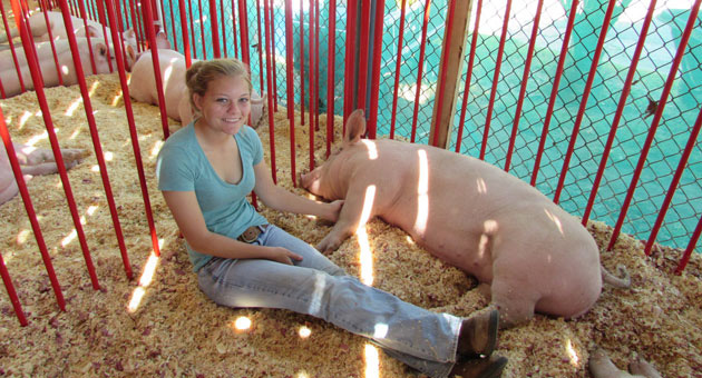 <p>Lompoc FFA member CIerra Green spends some time Monday with her pig Darla at the Santa Maria Fairpark.</p>