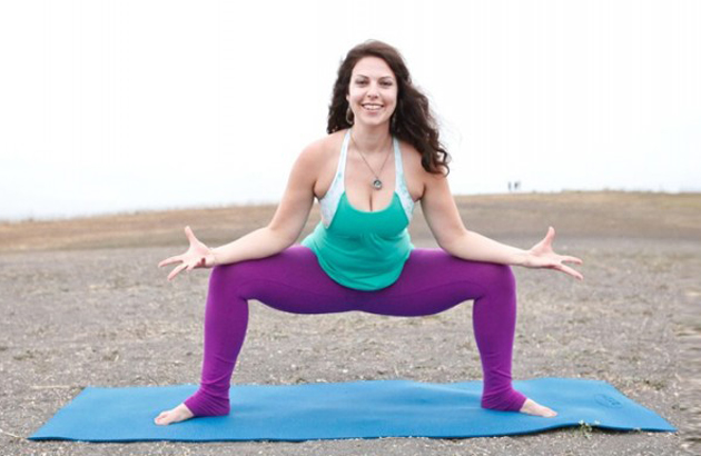 <p>Melanie Elkin, demonstrating the horse pose, is the founder and creator of Santa Barbara-based Yoga'licious. (Yoga'licious photo)</p>