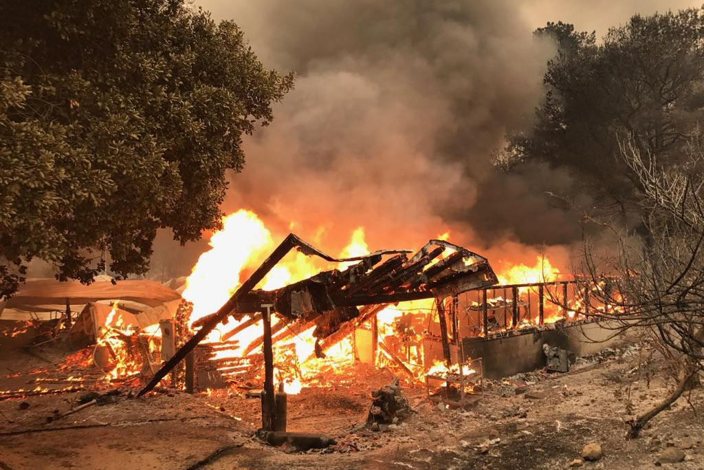Rancho Alegre goes up in flames in the early hours of the Whittier Fire. (Ray Fire / Noozhawk photo)