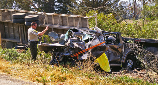 California Highway Patrol investigators are still trying to determine why a flatbed truck and trailer veered across a Highway 101 median west of Goleta last month. The subsequent headon collision with a pickup truck killed an Orange County woman and seriously injured her husband.  (Tom Bolton / Noozhawk file photo)