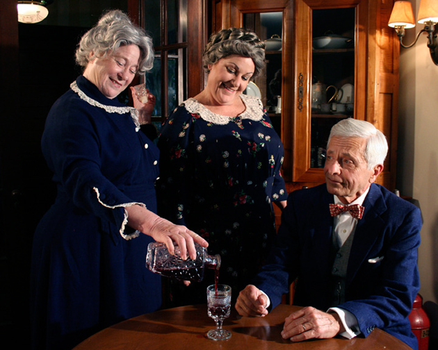 <p>The Brewster sisters pour some of their famous elderberry wine for a guest in SBCC Theatre Group&#8217;s production of <em>Arsenic and Old Lace</em>, running through July 26.</p>