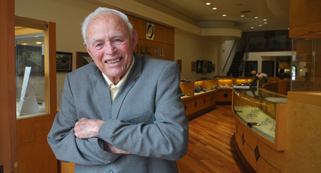 <p>Richard Kern, 93, stands in the doorway of his State Street shop, Churchill Jewelers. Though Kern says he has tried to retire, he can still be found in the store six days a week.</p>