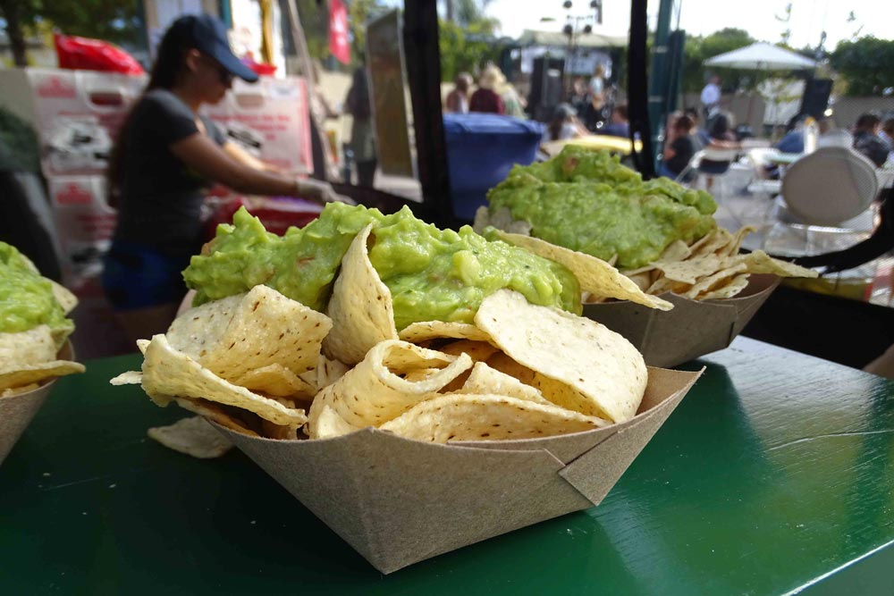 Festival visitors grabbed up chips and homemade guacamole made by Holy Guaca-Moly.