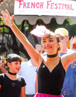 Claudia Lopez, 11, dances during a show at the French Festival on Saturday