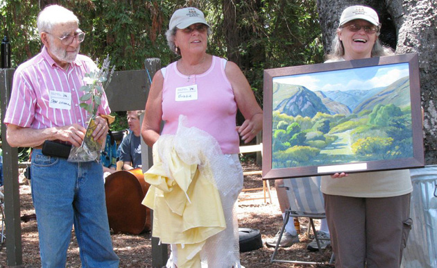 <p>Santa Barbara Audubon Society outgoing president Darlene Chirman holds up her gift of a John Iwerks painting of the Arroyo Hondo Preserve.</p>