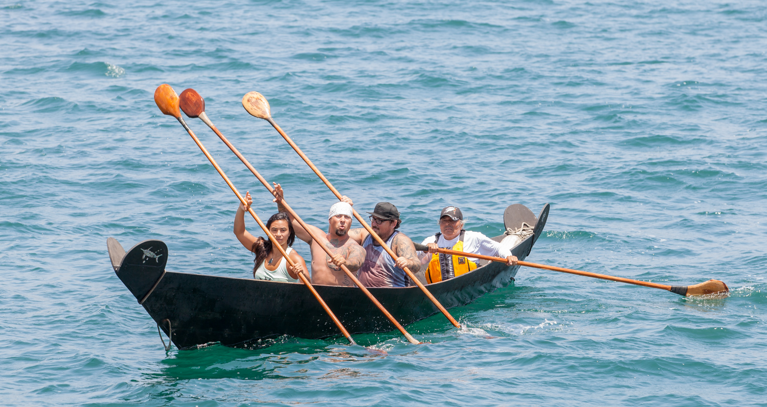 A group paddling a tomol, the traditional boat of the Chumash, could be seen from the Double Dolphin as part of the Old Spanish Days parade Grand Marshal announcement.
