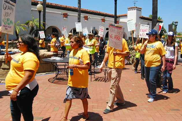 Members and supporters of the UFCW grocery store workers union rally at the Santa Barbara downtown Ralphs supermarket in July to ask for a fair labor contract.