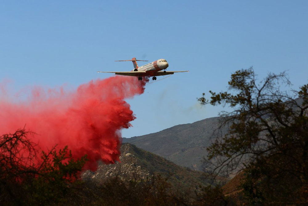 Coming in hot with a load of retardant, near Calle Lippazana Road east of El Capitán Canyon while trying to outflank the Whittier Fire on July 14.