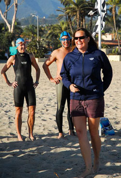 Reef and Run co-founder Jane Cairns briefs swimmers before the mile swim at East Beach on Tuesday.