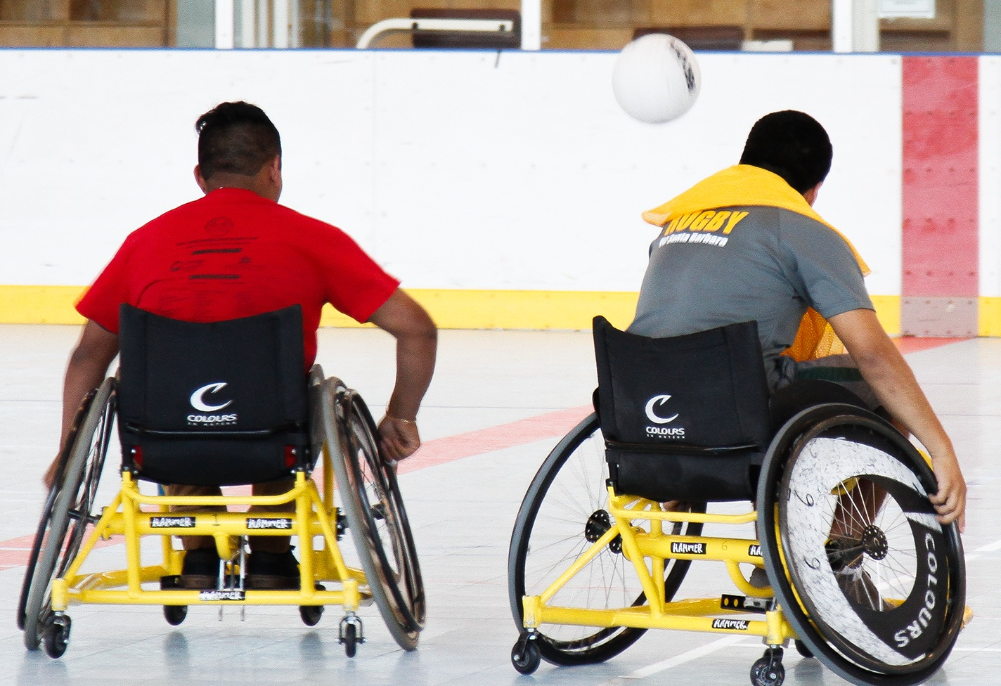 Players chase after the ball during Wheelchair Camp rugby game at the UCSB Rec Center multi-activity  center.