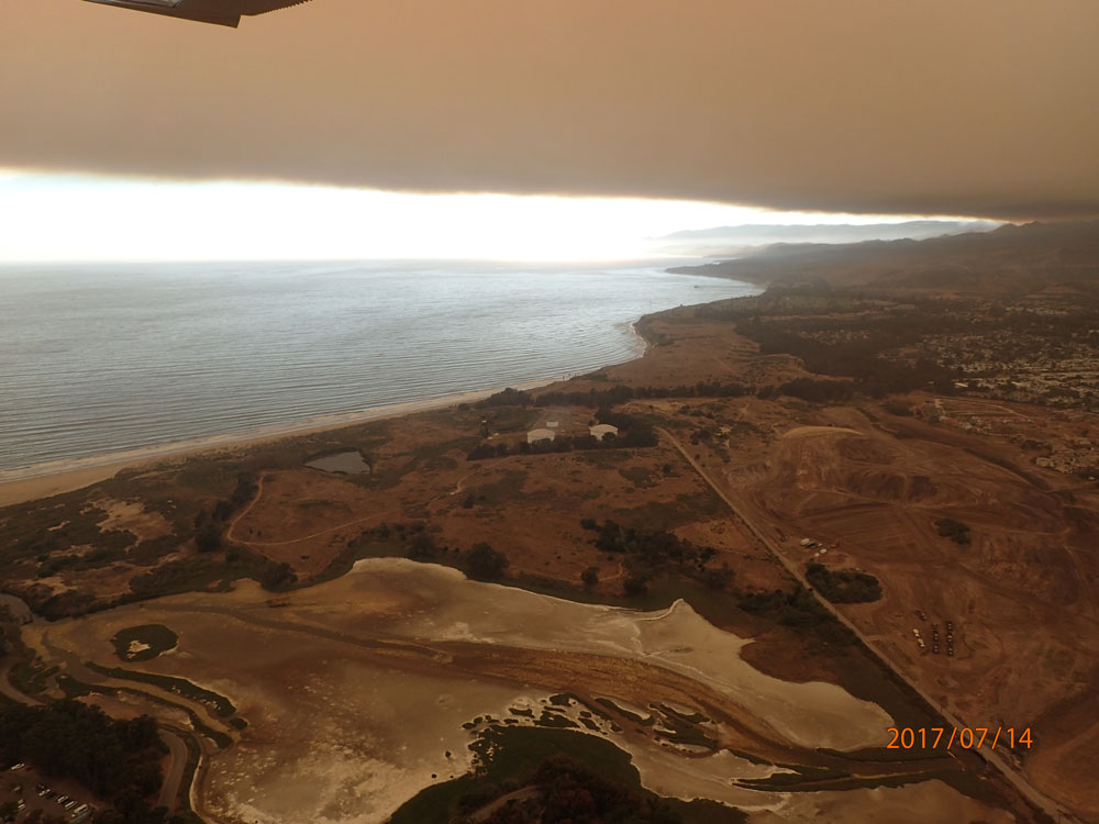 Smoke frome the Whittier Fire casts a pall over the Devereux Slough in this view from a Santa Barbara County Sheriff's Aero Squadron aircraft.