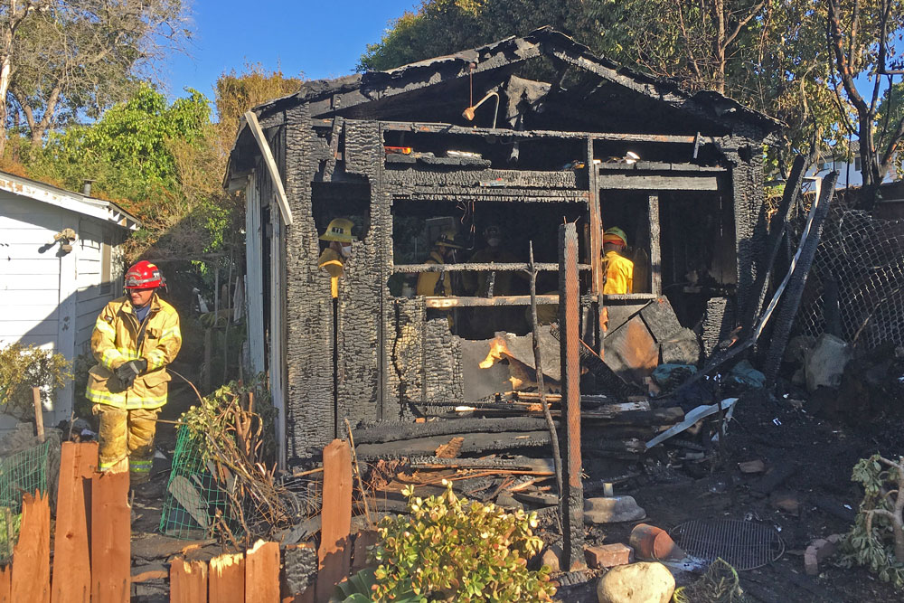 Firefighters at scene of burned-out shed in Santa Barbara.