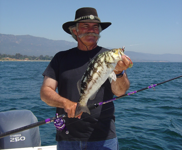<p>Capt. David Bacon with a freshly caught calico bass. He says calico bass care about scents, and they are a blast to catch on light tackle.</p>