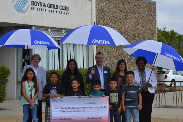 Representatives of Aera Energy recently presented a $50,000 donation to the Boys & Girls Clubs of Santa Maria Valley to help underwrite the cost of replacing the facility's roof.