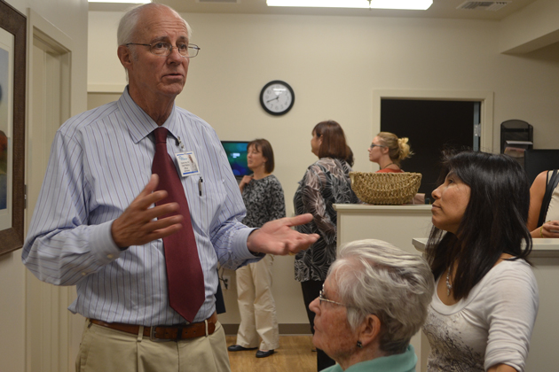 Dr. Charles Fenzi leads a tour of the newly-opened Goleta medical clinic in June 2015. He has been named as the new CEO of Santa Barbara Neighborhood Clinics.