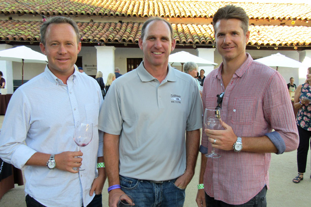 The new owners of the California Wine Festival, from left, Sean Hecht, Chris Bellamy and Blaine Lando, enjoy the beginning of three days of festivities at Thursday night's Old Spanish Nights event at the historic De La Guerra Adobe.