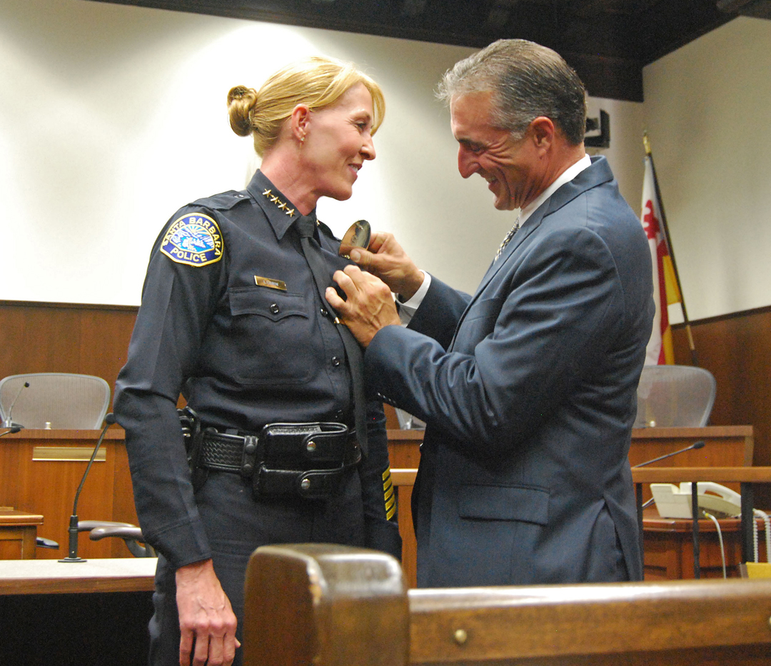 Santa Barbara Police Chief Lori Luhnow gets sworn into the job. Her fiance Marc Homan pinned on her badge at the July ceremony. Homan died unexpectedly at his home in Coronado Aug. 25.