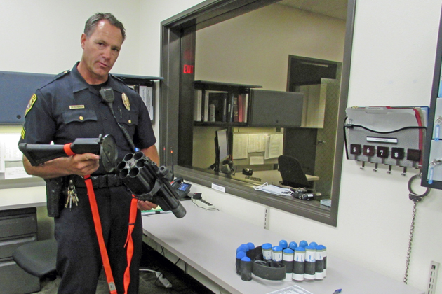 Sgt. Mark Streker of the Santa Maria Police Department shows the weapon to fire 40mm sponge rounds, one of the less lethal options available to officers.