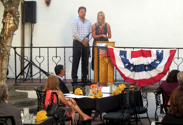 Todd and Laura Capps speak to the crowd during the tribute to their mother, Congresswoman Lois Capps.