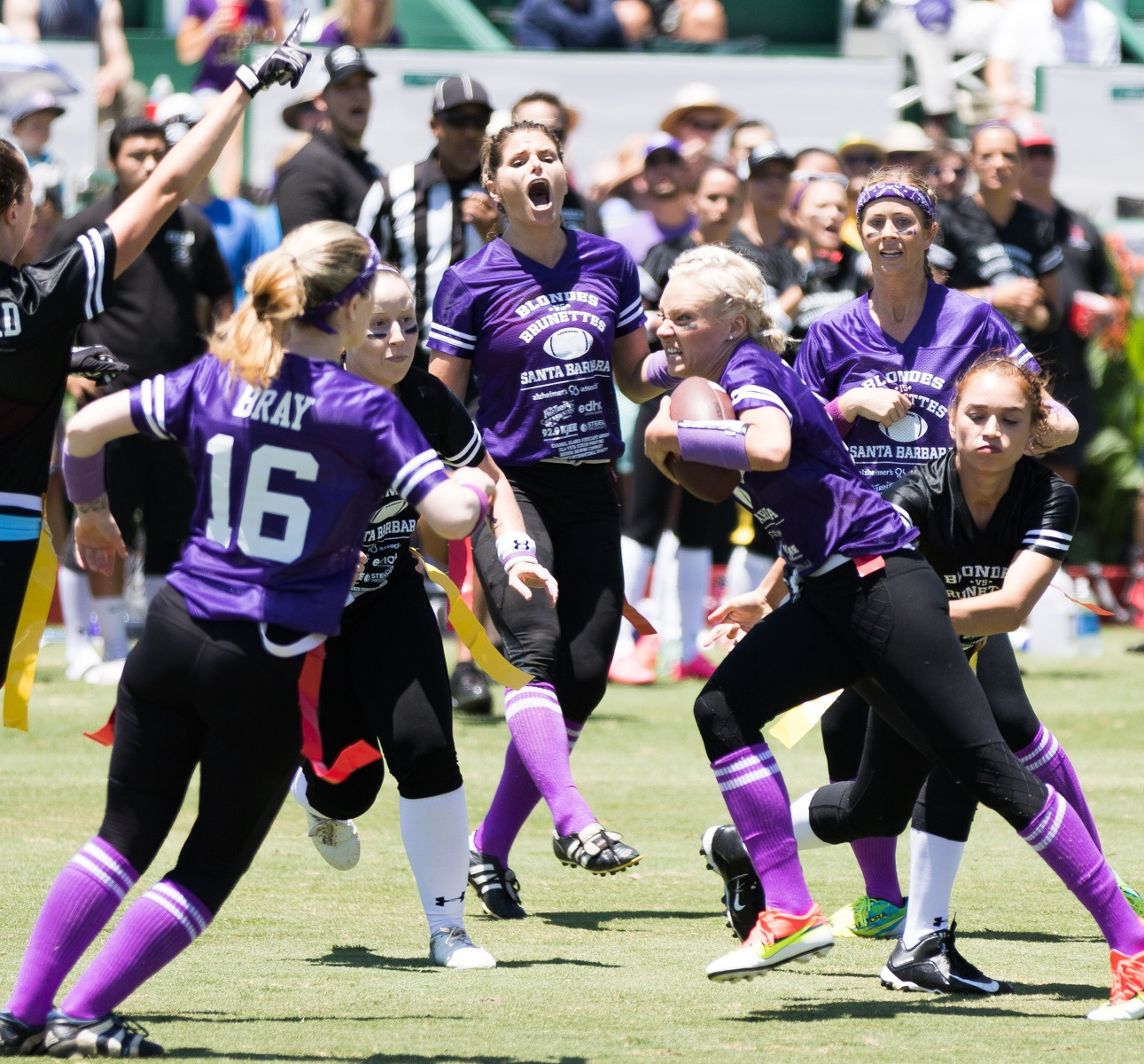 Christianne Taylor of Team Blonde looks for running room during Saturday's Blondes vs. Brunettes women's flag football game at the Santa Barbara Polo & Racquet Club.