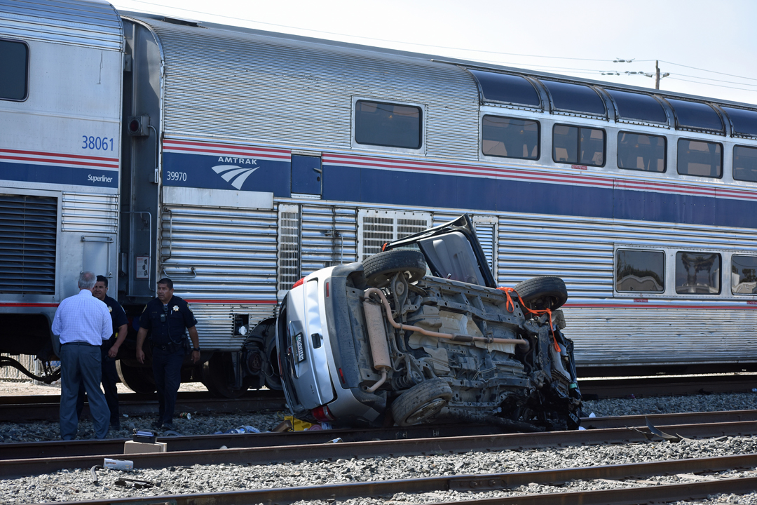 Guadalupe police investigate after a vehicle on the railroad tracks was struck by an Amtrak passenger train Monday afternoon.