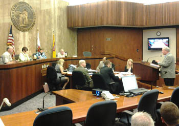Several public speakers stepped forward Thursday to voice opposition to a proposal to begin charging visitors to park at Santa Barbara County's seven beaches. (Patrick Kulp / Noozhawk photo)