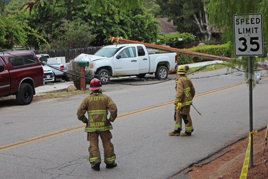 A truck knocked a power pole into the street on North San Marcos Road Friday morning.
