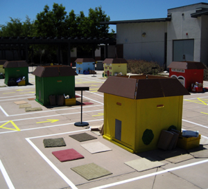 Safety Town is equipped with traffic signs and tricycles where kids practice what they learn in the classroom