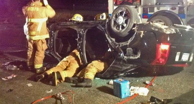 <p>Firefighters work to extricate a critically injured patient from a vehicle that crashed early Tuesday in Buellton.</p>